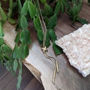 Gold cowboy tie style necklace